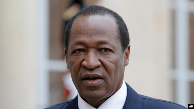 FILE - Blaise Compaore, who at the time was Burkina Faso's president, speaks to reporters in Paris, Sept. 18, 2012.