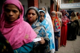 Women stand in a line to cast their vote at a polling centre during parliamentary elections in Dhaka, Bangladesh, Jan. 5, 2014.