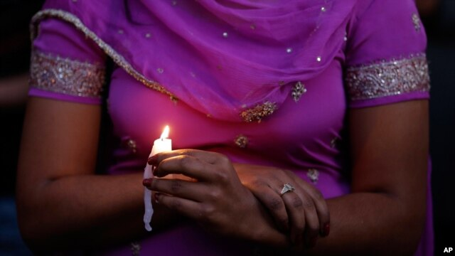 A candle light vigil was held in Milwaukee, Wisconisn for the victims of the Sikh Temple shooting, August 5, 2012.