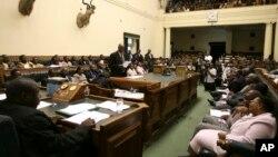 FILE: Then Zimbabwean Justice Minster Patrick Chinamasa, center, motions to pass constitutional amendment bill in parliament , Harare, Feb. 2009.