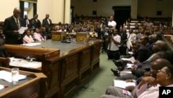 Zimbabwean Justice Minister Patrick Chinamasa, center, speaking in parliament about Zimbabwe's ballooning debt.