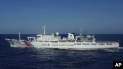 In this photo released by Japan's 11th Regional Coast Guard, a China Coast Guard vessel numbered 2506 sails in waters 66 kilometers (41 miles) from the East China Sea islands called Senkaku by Japan and Diaoyu by China Wednesday, July 24, 2013.