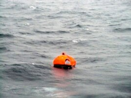 In this photo taken from a nearby boat showing a life raft from the Italian-flagged Norman Atlantic ferry after it caught fire in the Adriatic Sea, Dec. 28, 2014.