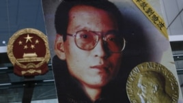 The picture of Chinese dissident Liu Xiaobo is carried by a protester demanding the release of Liu Xiaobo outside the China's Liaison Office in Hong Kong, October 11, 2010.