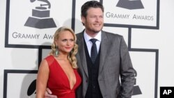 FILE - Miranda Lambert, left, and Blake Shelton arrive at the 56th annual Grammy Awards at the Staples Center in Los Angeles, Jan. 26, 2014.