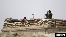 FILE - Fighters of the Syria Democratic Forces held a watchful position near Raqqa, Syria, May 27, 2016.