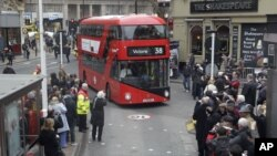 Double decker bus approaches London's Victoria Station.