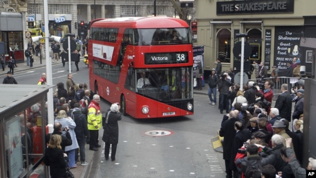 Double decker bus approaches London's Victoria Station.