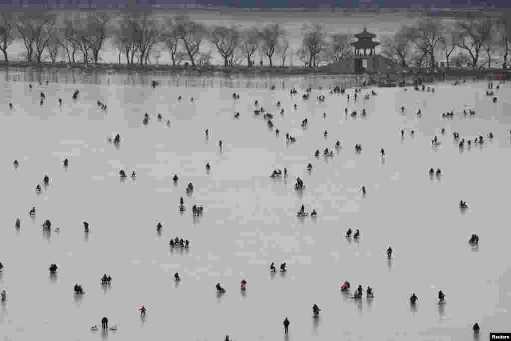 People visit a skating rink on the frozen Kunming Lake at the Old Summer Palace in Beijing, China Jan. 21, 2018.
