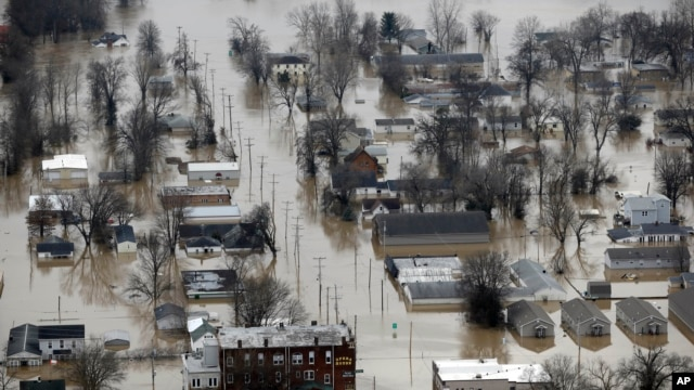 Homes surrounded by floodwater, Wednesday, Dec. 30, 2015, in Pacific, Mo.