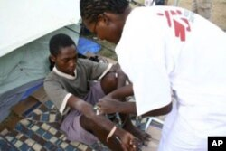 A MSF medical worker gives an injection to a young man in Zimbabwe