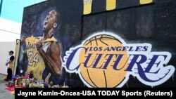 Fans gather at a mural painted in an alley on Lebanon St in Los Angeles pays tribute to Kobe Bryant who was killed in a helicopter crash Jan 26, 2020. Mandatory Credit: Jayne Kamin-Oncea-USA TODAY Sports