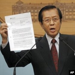 Taiwan's FM Timothy Yang holds evidence during an impromptu press conference to denounce Beijing's move in pressuring the World Health Organization to recognize Taiwan as part of China, in Taipei, Taiwan, May 10, 2011