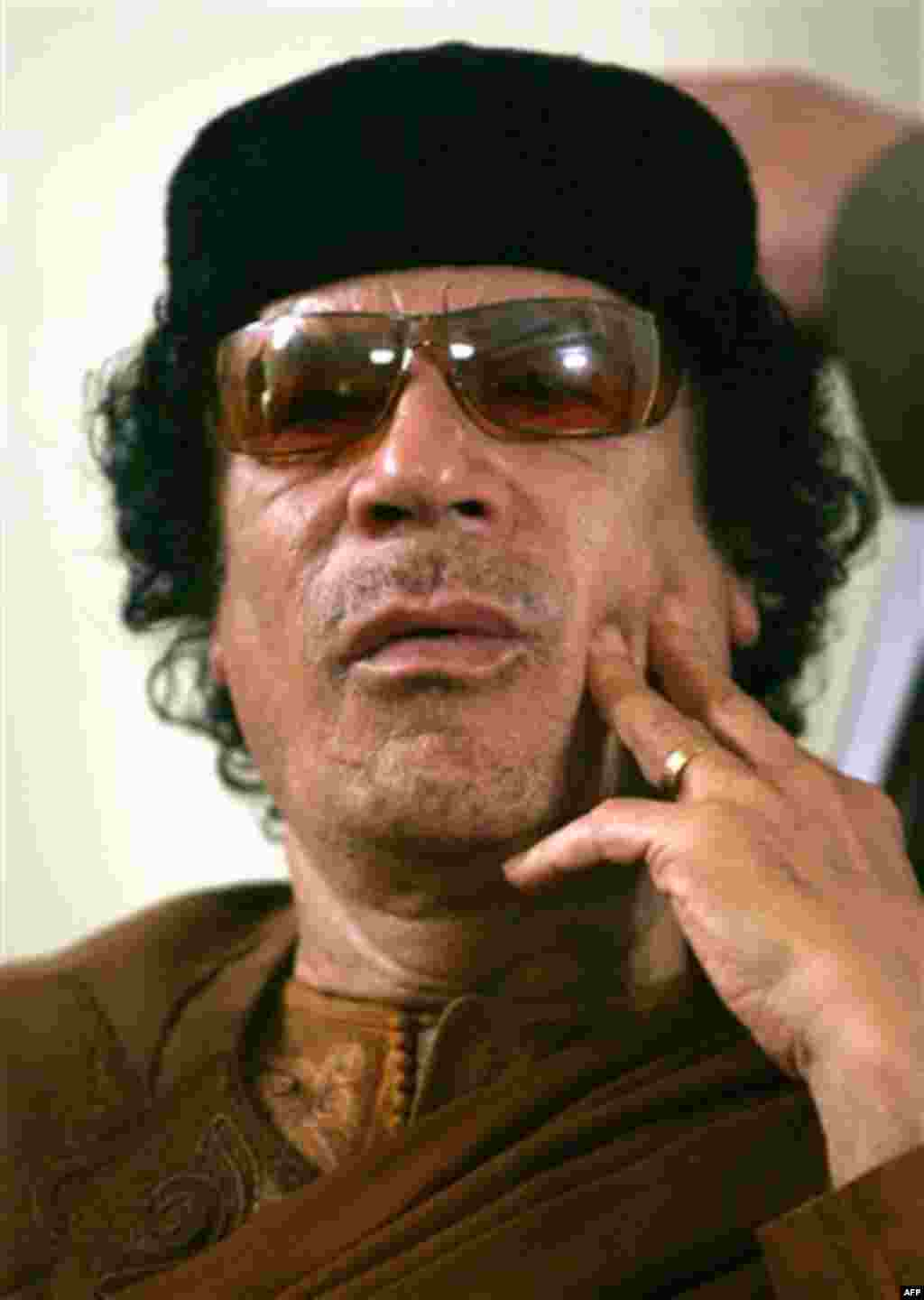 FILE.- This Friday, March 2, 2007 file photo shows Libya's Moammar Gadhafi in Sabha, Libya Friday, March 2, 2007. Hundreds of Libyans calling for the government's ouster took to the streets early Wednesday in the country's second-largest city as Egypt-in