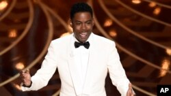 Chris Rock hosts the Academy Awards program at the Dolby Theatre in Los Angeles, Feb. 28, 2016.