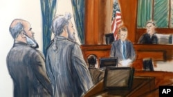 FILE - In this courtroom sketch, from left, Suliman Abu Ghaith stands next to his attorney, Stanley Cohen, as courtroom deputy Andrew Mohan, reads the verdict and Judge Lewis Kaplan, right, listens, March 26, 2014, at federal court in New York.