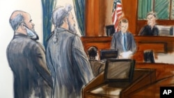 FILE - In this courtroom sketch, from left, Suleiman Abu Ghaith stands next to his attorney, Stanley Cohen, as courtroom deputy Andrew Mohan, reads the verdict and Judge Lewis Kaplan, right, listens, March 26, 2014 at federal court in New York.