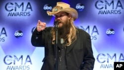 "Chris Stapleton, winner of the awards for new artist of the year, album of the year for ""Traveller,"" and male vocalist of the year, at the CMA Awards, Nov. 4, 2015."