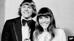 FILE - The Carpenters, Richard and Karen, pose with their Grammy during the 13th annual 1970 Grammy Awards in Los Angeles, California, March 17, 1971.