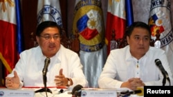 Philippine chief government negotiator Carlos Sorreta (L) speaks next to Pio Lorenzo Batino, Philippine Department of National Defense, Undersecretary for Legal and Legislative Affairs and Strategic Concerns during a news conference at the military headqu