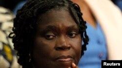 IL'ancienne première dame ivoirienne, Simone Gbagbo, lors de sa première comparution à la cour d'assise d'Abidjan, le 26 décembre 2014.