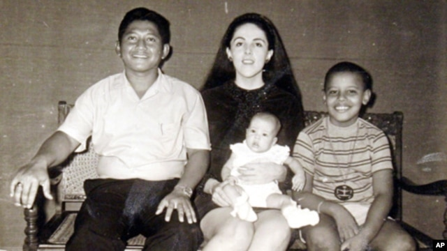 The author - Maya Soetoro-Ng - as a baby and  her brother, Barack Obama, with their mother, Ann Dunham, and her father, Lolo Soetoro, in an undated family snapshot.
