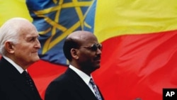 Dr. Negaso Gidada Solan (right) bids farewell to then-Italian President Oscar Luigi Scalfaro (left) in 1997. Ethiopia's first president, Gidada later became active in Ethiopia's opposition politics.