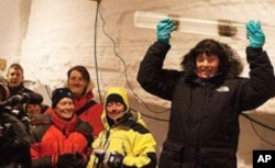 Project leader Dorthe Dahl Jensen holding the final piece of ice extracted from 2537.36 meters.