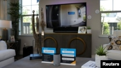 "An Amazon Echo displays a video feed of the front door on a TV in the living room of an Amazon ""experience center"" in Vallejo, California, May 8, 2018."
