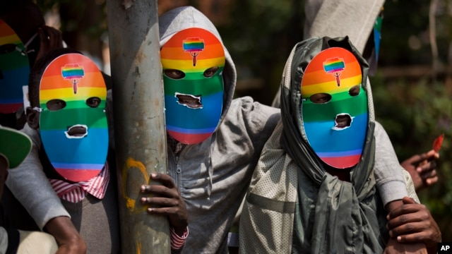 Kenyan gays, lesbians and others supporting their cause, wear masks to preserve their anonymity as they stage a protest against Uganda's increasingly tough stance against homosexuality, outside the Uganda High Commission in Nairobi, Kenya, Feb. 10, 2014.