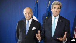 U.S. Secretary of State John Kerry, right, and French Foreign Affairs Minister Laurent Fabius give a press conference following talks at the Quai d'Orsay in Paris Wednesday Nov. 5, 2014.