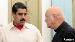 Venezuela's President Nicolas Maduro speaks with Claudio Maria Celli, the Vatican's representative, in Caracas, Venezuela