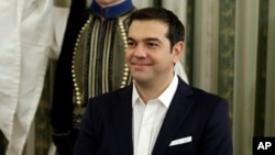 Greece's Prime Minister Alexis Tsipras attends his cabinet's swearing in ceremony at the presidential palace in Athens, Sept. 23, 2015.
