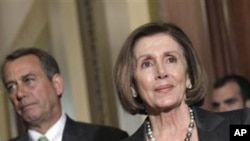 House Speaker House John Boehner of Ohio, left, stands next to House Minority Leader Nancy Pelosi of Calif., on Capitol Hill in Washington, Wednesday, April 6, 2011, during a break from work on the federal budget.