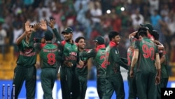 Bangladesh players celebrate their win over Pakistan in the one day international cricket match of Asia Cup in Abu Dhabi, United Arab Emirates, Wednesday, Sept. 26, 2018