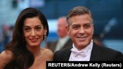 Osnivači Kluni fondacije za pravdu bračni par Amal i Džorž Kluni (Foto: Reuters/Andrew Kelly)