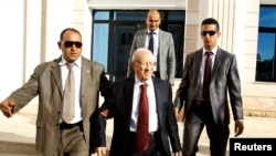 FILE - Beji Caid Essebsi (C), former Tunisian PM and leader of Nida Touns (Call of Tunisia) secular party, leaves after talks between ruling Islamists and the opposition to pave the way for the formation of a transitional government, Tunis, Nov. 4, 2013.