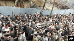 Kashmiri villagers carry the body of Manzoor Magray during his funeral at Chogal village in Handwara town, Kupwara, February 5, 2011