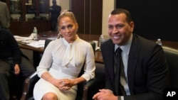 FILE - Alex Rodriguez, left, and Jennifer Lopez participate in a panel at Project Destined Bronx Bootcamp at Yankee Stadium in New York, March 4, 2018.