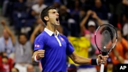 Novak Djokovic, of Serbia, reacts after breaking Roger Federer's serve to win a game in the fourth set during the men's championship match of the U.S. Open tennis tournament, Sunday, Sept. 13, 2015.