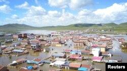 چین کے صوبے سیچوان کا ایک گاؤں سیلابی پانی میں ڈوبا ہوا ہے۔