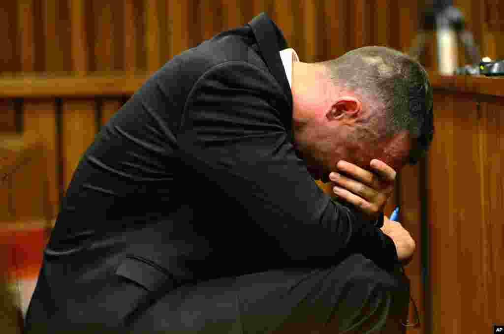 Oscar Pistorius cradles his head in his hands during court proceedings in Pretoria, May 5, 2014.