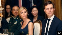FILE - Ivanka Trump, second from right, the daughter and assistant to President Donald Trump, is seated with her husband, White House senior adviser Jared Kushner, right, during a dinner with President Donald Trump and Chinese President Xi Jinping at Mar-
