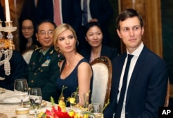 FILE - Ivanka Trump, second from right, the daughter and assistant to President Donald Trump, is seated with her husband, White House senior adviser Jared Kushner, right, during a dinner with President Donald Trump and Chinese President Xi Jinping at Mar-a-Lago in Palm Beach, Florida, April 6, 2017. Earlier in the day, Ivanka Trump's company received provisional approval from the Chinese government for three new trademarks, winning monopoly rights to sell Ivanka brand jewelry, bags and spa services in the world's second-largest economy.