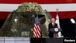U.S. Vice President Mike Pence visits the Kennedy Space Center in Florida July 6, 2017. Behind Pence is an Orion Capsule that will be launched at a future date.