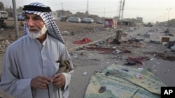 """An Iraqi man stands near a bombing site in Baghdad in August 2009. The book, ''The Strong Horse,"""" asserts Arab culture is to blame for violence in the Middle East and for the failure of peace initiatives."""