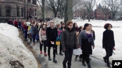 Hundreds of Brown University students march across campus, Wednesday, March 11, 2015, in Providence, R.I., to protest how the college handled recent sexual assault allegations. (AP Photo/Amy Anthony)