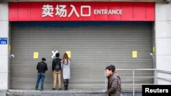图为3月5日杭州关门歇业的乐天超市