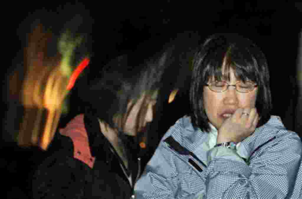A Japanese woman reacts Friday, April 8, 2011 in Ishinomaki, Iwate Prefecture, northern Japan, after a 7.1-magnitude earthquake struck offshore, late Thursday. (AP Photo/Vincent Yu)