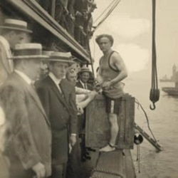 Harry Houdini prepares to be closed in the crate and lowered into the New York Harbor.